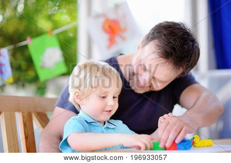 Little Boy With His Father Playing With Colorful Modeling Clay