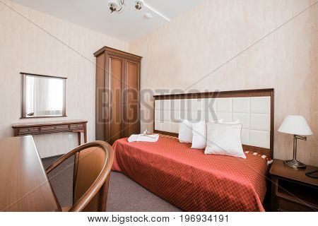 Hotel apartment, bedroom interior in the morning. single room, with bed