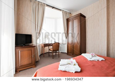 Hotel apartment, bedroom interior in the morning. stadart room, with large double bed