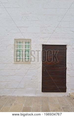 Traditional facade of south adriatic sea house with door and window minimalist decorated in small village of Monopoli south Italy