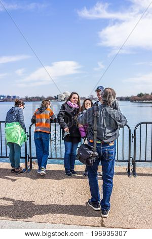Washington Dc, Usa - March 17, 2017: Photographer Taking Picture Of Family Looking Over Tidal Basin