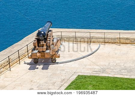 One of the ceremonial guns of the Saluting Battery which fire gun signals daily as seen from the Upper Barrakka Gardens in Valletta Malta.