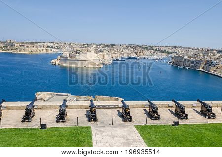The Saluting Battery as seen from the Upper Barrakka Gardens and Fort Saint Angelo a large bastioned fort in Birgu Malta