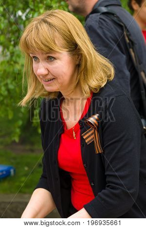 BERLIN - MAY 08 2015: Victory in Europe Day. Treptower Park. Woman with St. George ribbon.