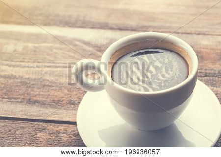 Cup of Cappuccino coffee on wooden table. Coffee in the morning concept