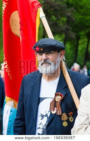 BERLIN - MAY 08 2015: Victory in Europe Day. Treptower Park. Communist activists in the commemorative event