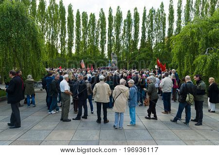 BERLIN - MAY 08 2015: Victory in Europe Day. Treptower Park. Anti-fascists in the commemoration ceremony near the sculpture of Motherland.