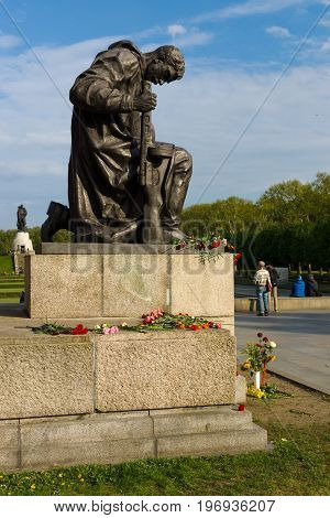 BERLIN - MAY 08 2015: Victory in Europe Day. Treptower Park. One of the kneeling soldier statues