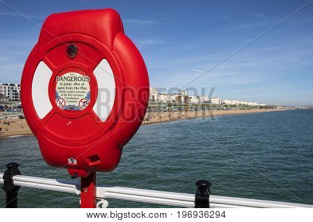 BRIGHTON UK - MAY 31ST 2017: A Life-Saving Ring and the view from the historic Brighton Pier in Brighton East Sussex on 31st May 2017.