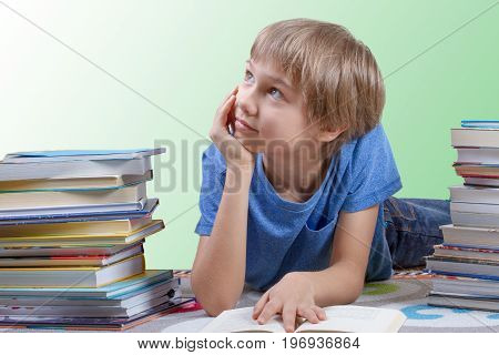 Child reading between the stack of books. Education, back to school concept