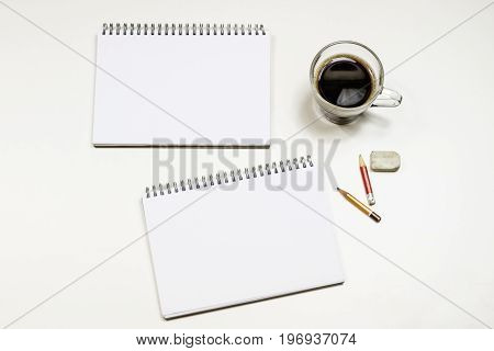 Coffee And Sketchbook For Drawings. White Table. Isolated Background.