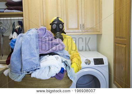 Woman In Haz Mat Suit Holding Basket Of  Laundry
