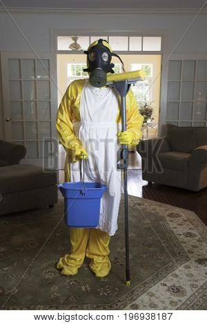 Mature Woman In Haz Mat Suit With Mop And Bucket