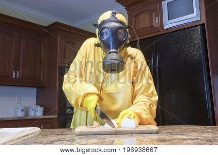 Mature Woman In Haz Mat Suit Chopping Onions