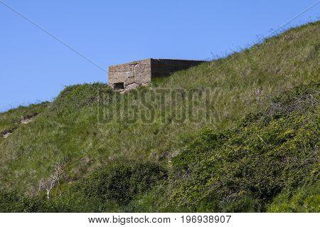 A panoramic view showing World War II defences at the estuary in Cuckmere Haven situated in the Seven Sisters Country Park in East Sussex UK.