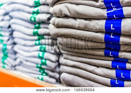 Large and extra large shirts stacked for sale on display in store