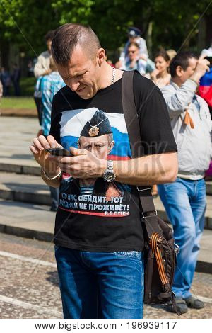 BERLIN - MAY 09, 2015: A man in a shirt with a portrait of Russian President Vladimir Putin.