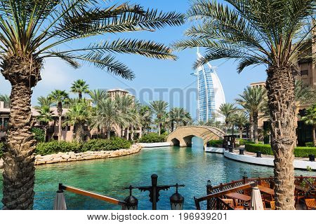 DUBAI, UNITED ARAB EMIRATES - DECEMBER 7, 2016: View at Burj Al Arab hotel from Madinat Jumeirah luxury resort in a summer day.