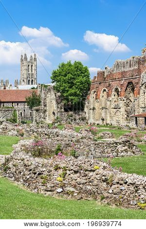 The remains of the oldest Benedictine monastery St Augustines Abbey in Canterbury. The tower of Canterbury Cathedral can be seen in the distance. Canterbury Kent United Kingdom