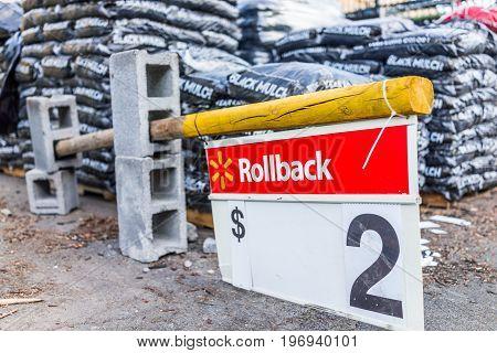 Burke, Usa - April 16, 2017: Macro Closeup Of Rollback Two Dollar Sign In Walmart Outside Garden Cen