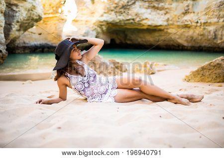 Beautiful Latin Woman Laying And  Enjoy The Summer Beach Time Near Ocean Caves Beautiful Beach