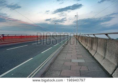 The Itchen road bridge over the River Itchen in Southampton, captured at early nightfall