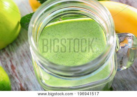 Mason jar of fresh juice, close up