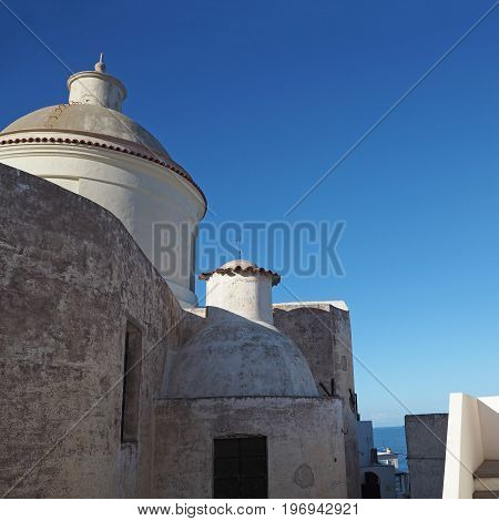 old white church on stromboli island Italy with blue sky background and sea