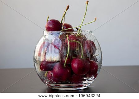 Bunch red cherry spheric transparent glass background