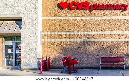 Fairfax, Usa - May 9, 2017: Target Store With Cvs Pharmacy Sign And Shopping Cart