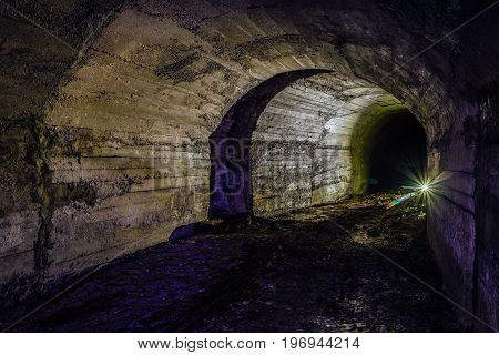 Abandoned bunker tunnel with concrete walls under Sevastopol
