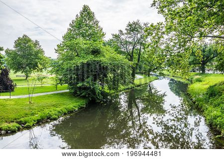 Frederick USA - May 24 2017: Carroll Creek in Maryland city Baker Park with bright green grass during summer