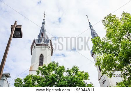 Frederick, Usa - May 24, 2017: Evangelical Lutheran Church Spires Isolated Against Sky With Lantern