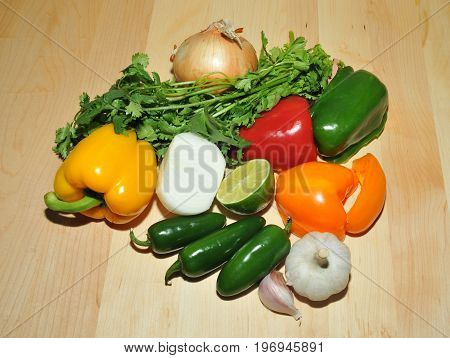 Fresh vegetables and herbs waiting to be made into salsa