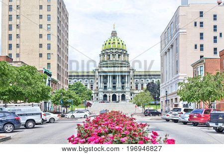 Harrisburg, Usa - May 24, 2017: Pennsylvania Capitol Exterior In City With Many Red Pink Rose Bushes