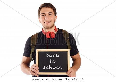 Close up of a young handsome man holding chalkboard with text