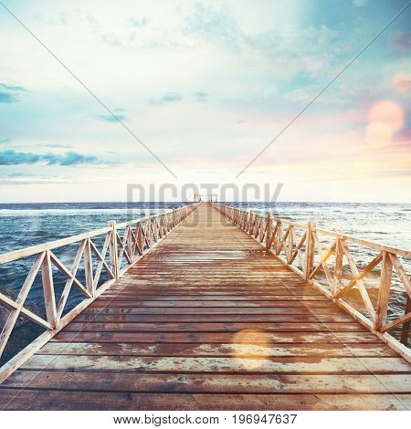 Pier on the sea at sunset. Freedom and relax concept