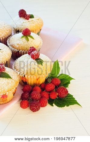 muffins with berries raspberries on a napkin