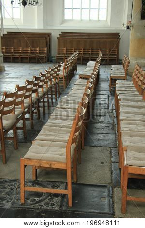 Simple wooden chairs in a Dutch Reformed Church