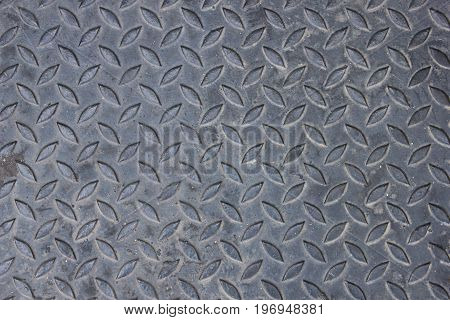 Old metal diamond plate or old checkered steel plate with rusty. background. texture.