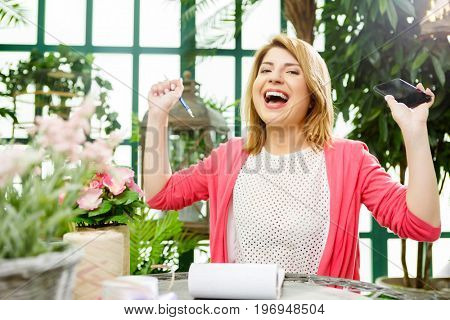 Laughing flower seller with phone