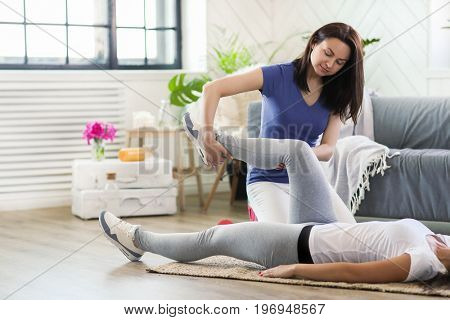 Woman is getting physical therapy from a professional doctor