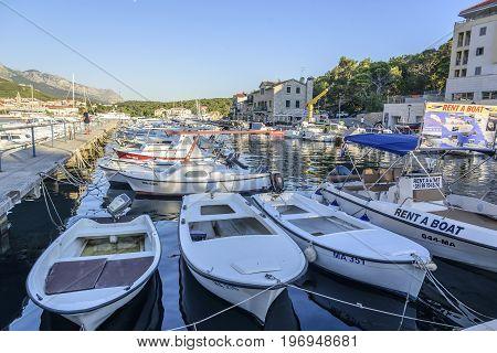 MAKARSKA RIVIERA, CROATIA - 5 JULY, 2017: Boats on the pier in the resort town of Makarska, Croatia.