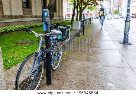 Montreal, Canada - May 26, 2017: Paid Bicycle Parking In City In Quebec Region In Downtown In Sidewa