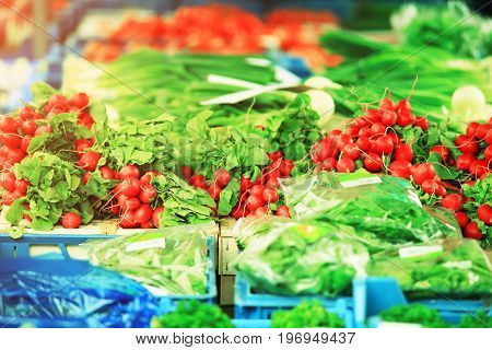 Fresh vegetables on storefront. Colorful vegetables on market.
