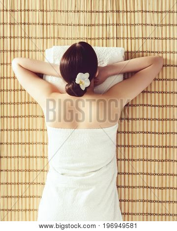 Young and healthy woman getting spa treatment in massaging salon. Health care, rejuvenation and relaxation concept.