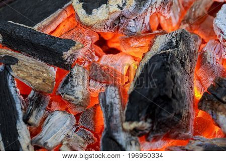 A warm fire in a chimney fire wood fireplace