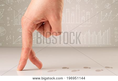 Female fingers walking on white surface with footsteps behind them