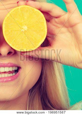 Girl Covering Her Eye With Lemon Citrus Fruit