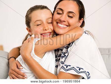 Beautiful Mom and Daughter having fun at home